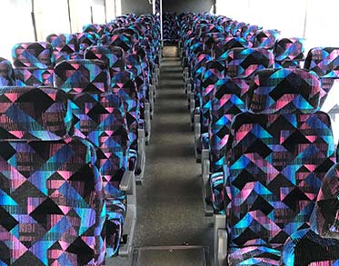 MBI Charters features armrests and footrests on every bus - MBI Charters