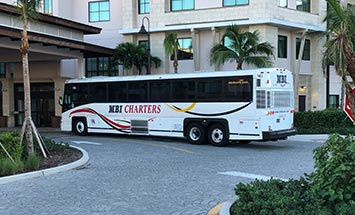 Wedding Party Bus Charter in front of hotel - MBI Charters